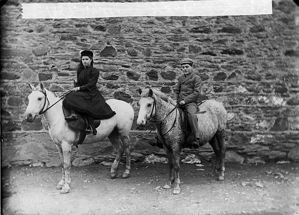 [A girl and a boy riding ponies (Williams)]