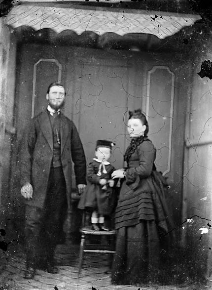 [A man, woman and a child]