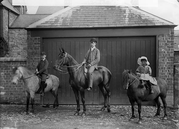 [Three people riding horses (Morris)]