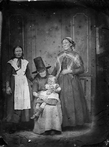 [Three women and a small girl]