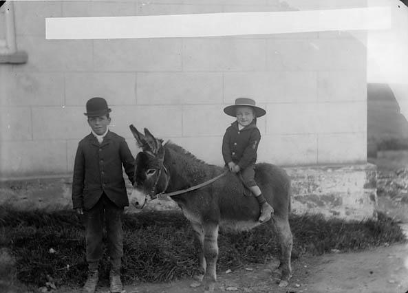 [A boy riding a donkey, Pembroke]