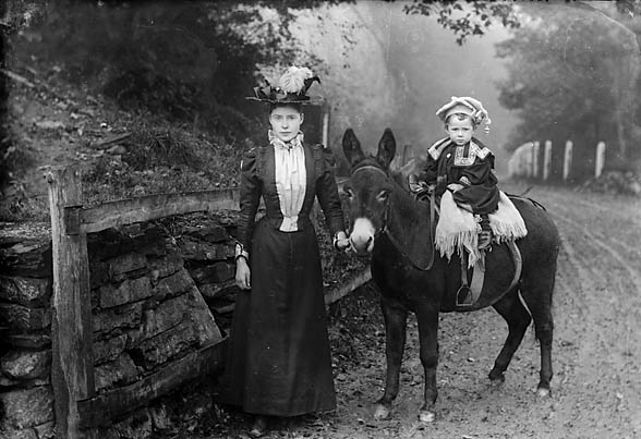 [Woman and a child on a donkey (Dickson)]