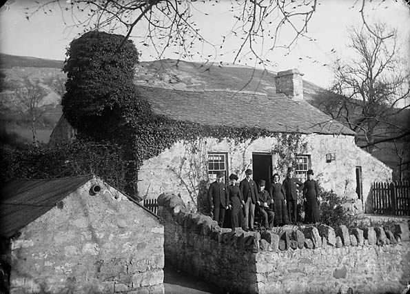 [Williams family in front of their house]