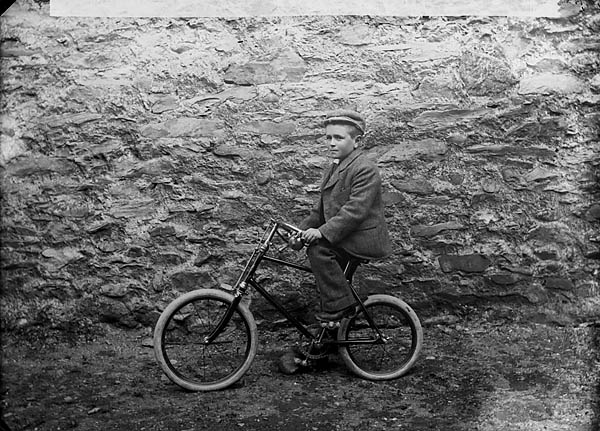 [Boy on a bicycle]