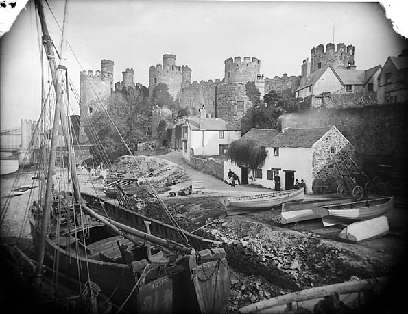 [Boats and ships on the river bank with the castle in the background, Conwy]
