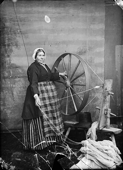 [Woman at spinning wheel]