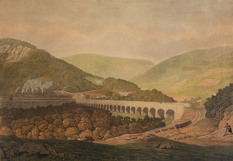 View of a stone bridge across the valley and river at Risca in Mon