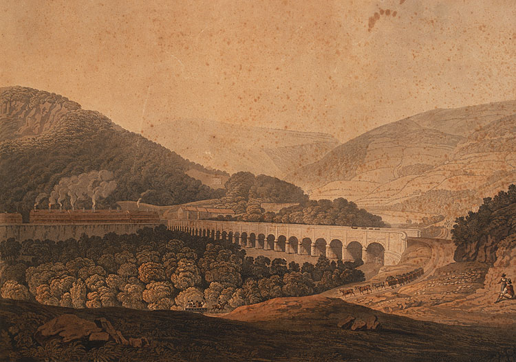 View of a stone bridge across the valley and river at Risca in Monmouthshire