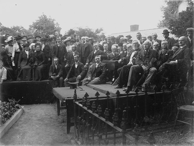 [Crowd of people congregated by the grave of Robert Owen at the old parish church, Newtown]