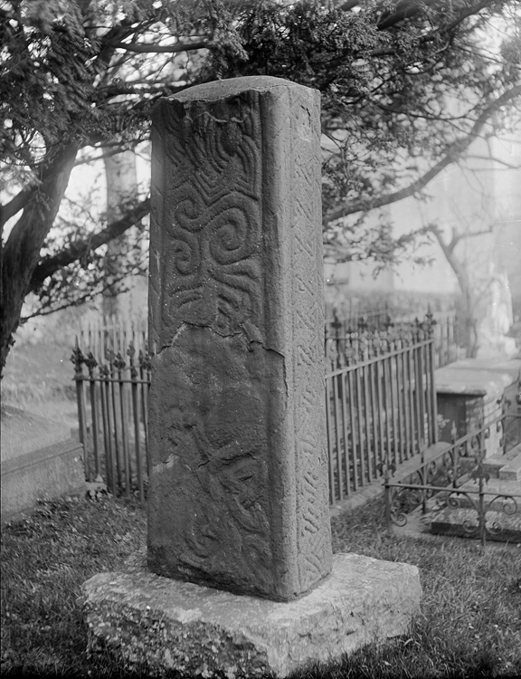[Celtic cross situated in the churchyard at St Nicholas and St Teilo's church, Penally]