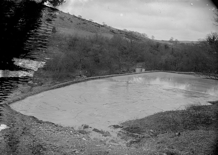 [A pond at Pumsaint gold mine]