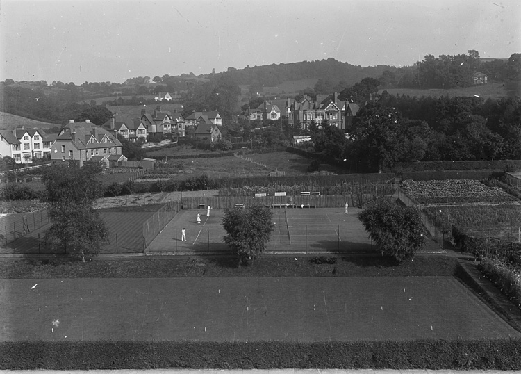 [View of unidentified village with tennis courts and allotments]