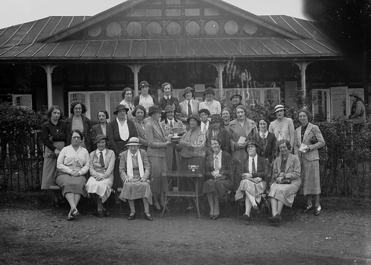 [Group of women golfers with trophies outside Llandrindod Golf Club Pavilion]