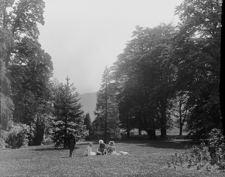 [Family picnic in lawned gardens]