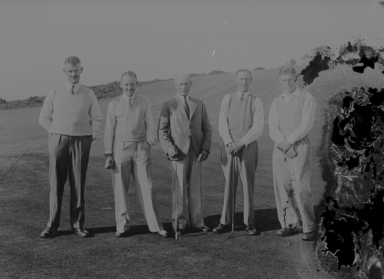 [Five gentlemen golfers on the golf course]