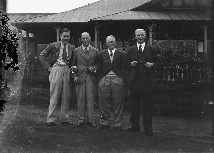 [Four men outside Llandrindod Wells Golf Club pavilion]