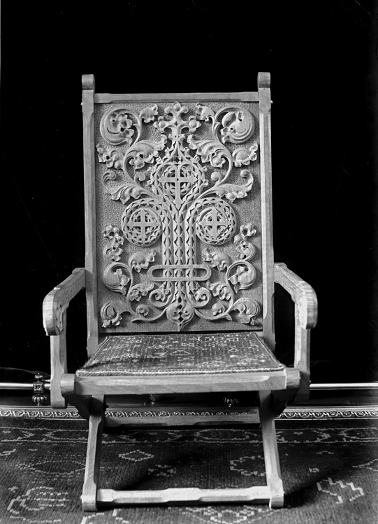 [Chair with ornately carved decoration]