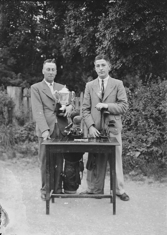 [Two men with a trophy, Builth Golf Club]