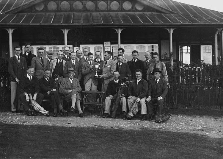 [Presentation to a male golfer outside Llandrindo Wells Golf Club pavilion]