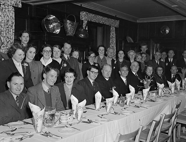 [Members of the Llanfyllin Welsh Society dining on St David's Day]