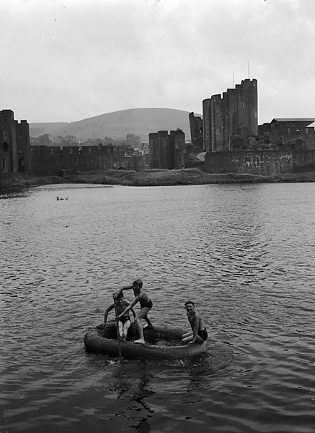 [Caerphilly boys rowing on the castle moat]