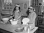[The girls of Ifton Heath School learn Domestic Science skills]