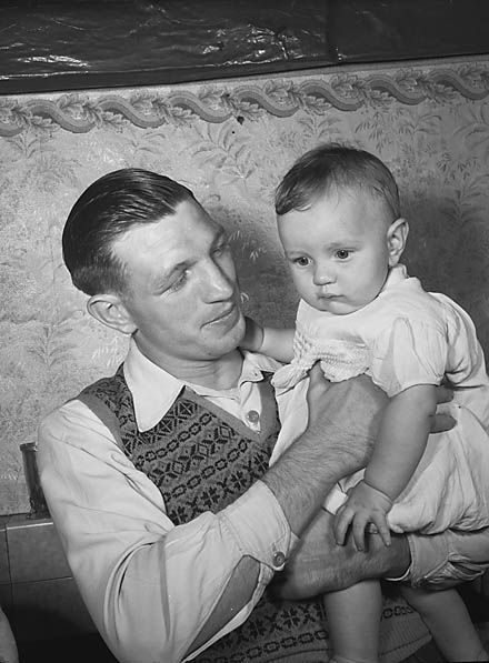 [Eddie Thomas, the boxer, with his baby, Edward]