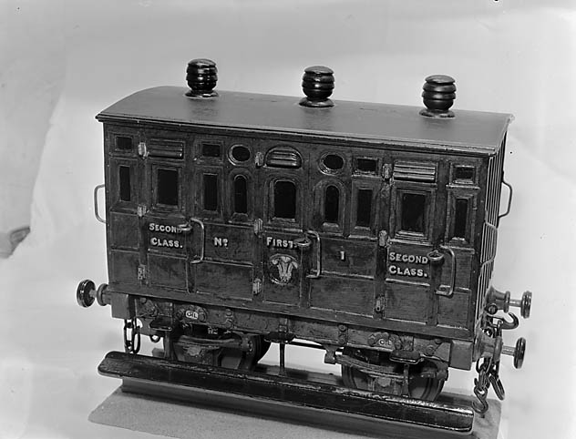 [A metal model of an old railway carriage]