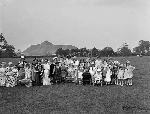 [Children's Fancy Dress Parade at St Martin's Football Field]