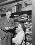 [Bob Owen, Croesor, with his wife and some of his books]