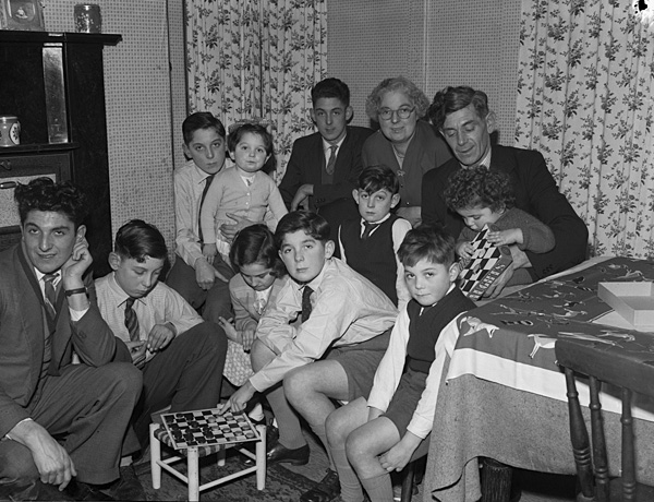 [Mr a Mrs Owen Meredydd Williams' children eagerly awaiting Christmas - all ten of them!]