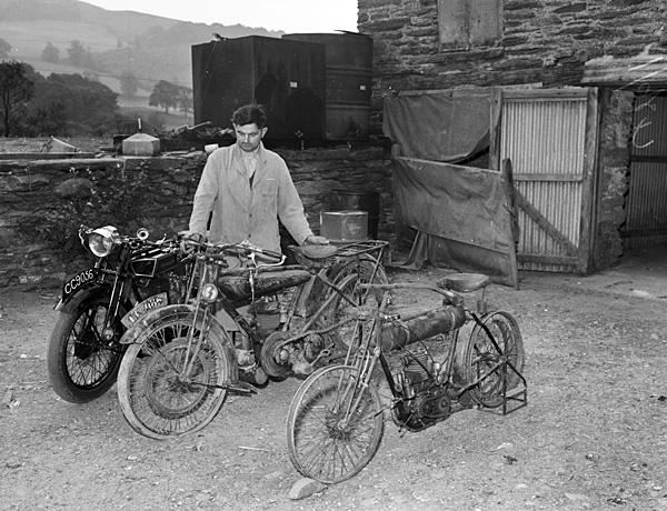 [John Lloyd with his motorcycles]