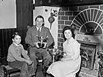 [A O Thomas, winner at the Blackpool Music Festival, with his wife and son]