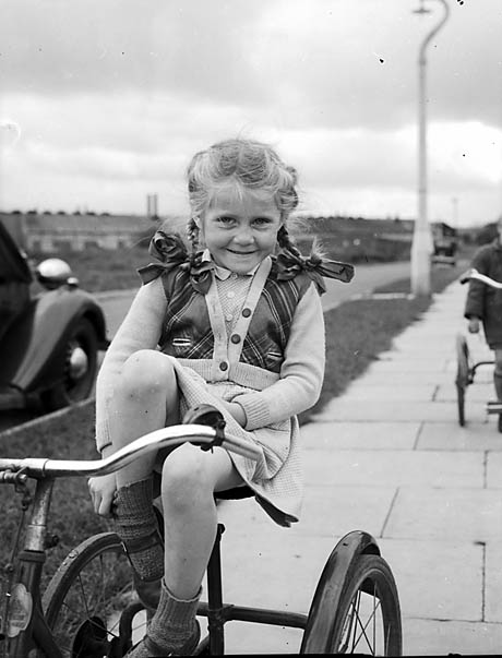 [Girl on a tricycle at Whittington]