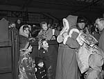 [Father Christmas arriving at Pwllheli by train]