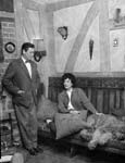 """[Mr and Mrs Ann Ford, """"Bear Brand"""" stockings, photographed in their home near Bala for """"Tŷ Ni""""]"""
