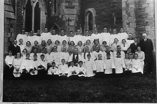 Old photograph of a church choir taken outside a church