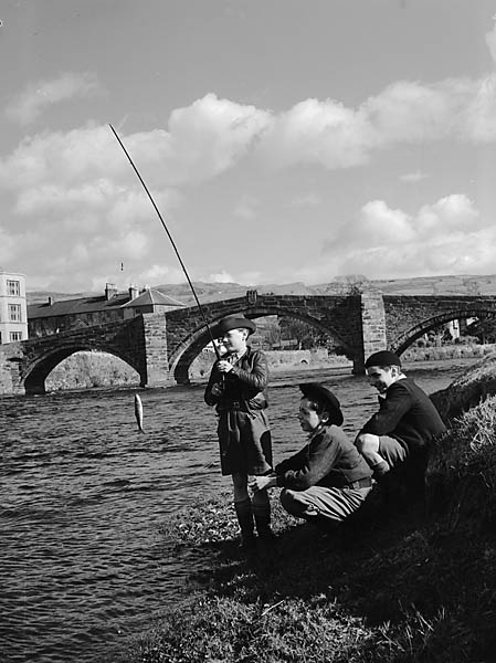[Three boys fishing at the side of the River Conwy in Llanrwst]