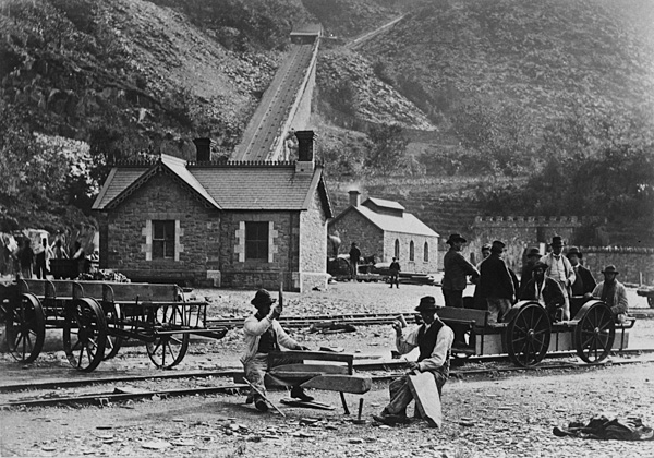"[Old photographs of places in North Wales showing the ""quiet leisure of an age gone by""]"