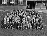 [Feature on Oswestry's Woodside Primary School as Headmaster, Mr H Hackett, retires]