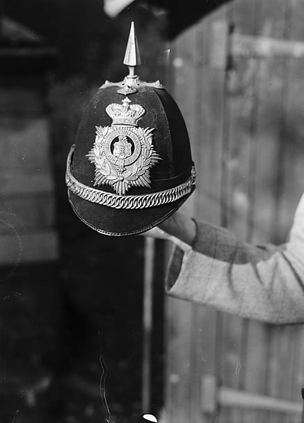 [Police Constable Tom Pritchard, Newbridge on Wye, with his helmet]