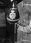 [Police Constable Tom Pritchard, Newbridge on Wye, with his helmet]