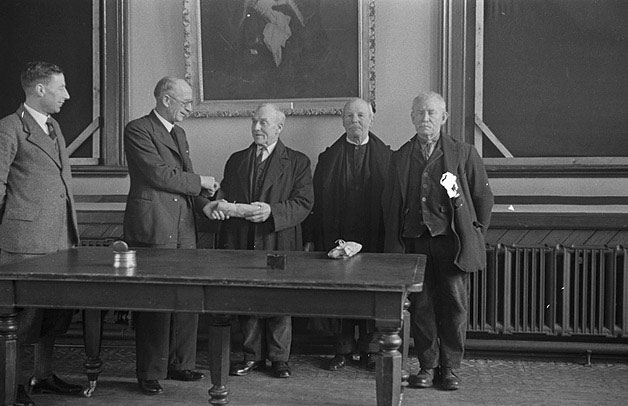 [Presentation by the Mayor F.W. Hughes to three retiring employees of Welshpool Corporation]