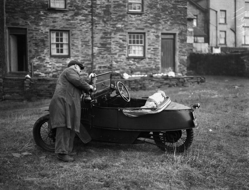 [Old Morgan car]