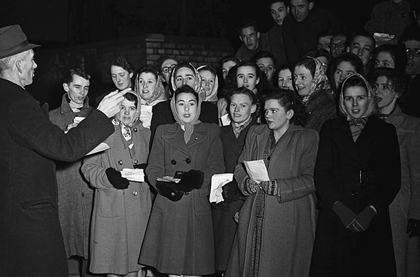 [Members of the Oswestry Urdd Branch singing carols around the town, Christmas 1948]