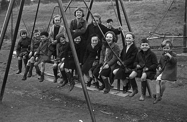 [Children on a swing at Newtown playing fields]