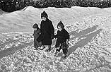 [Snow scenes in Newtown, and Geoff Charles' family]