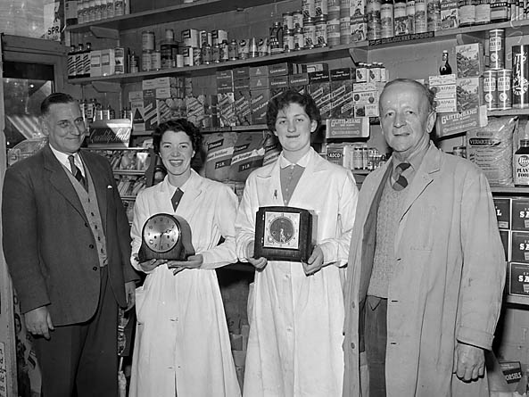 [Presentations of clocks to two employees at Jones and Co (Seedsmen), Oswestry]