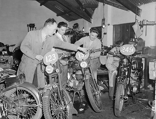 [Preparing motor cycles for the International Six Days Trial at Roy Evans' Motor Cycles, Oswestry]
