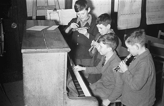 [Caersws schoolchildren engaged in making music and knitting]